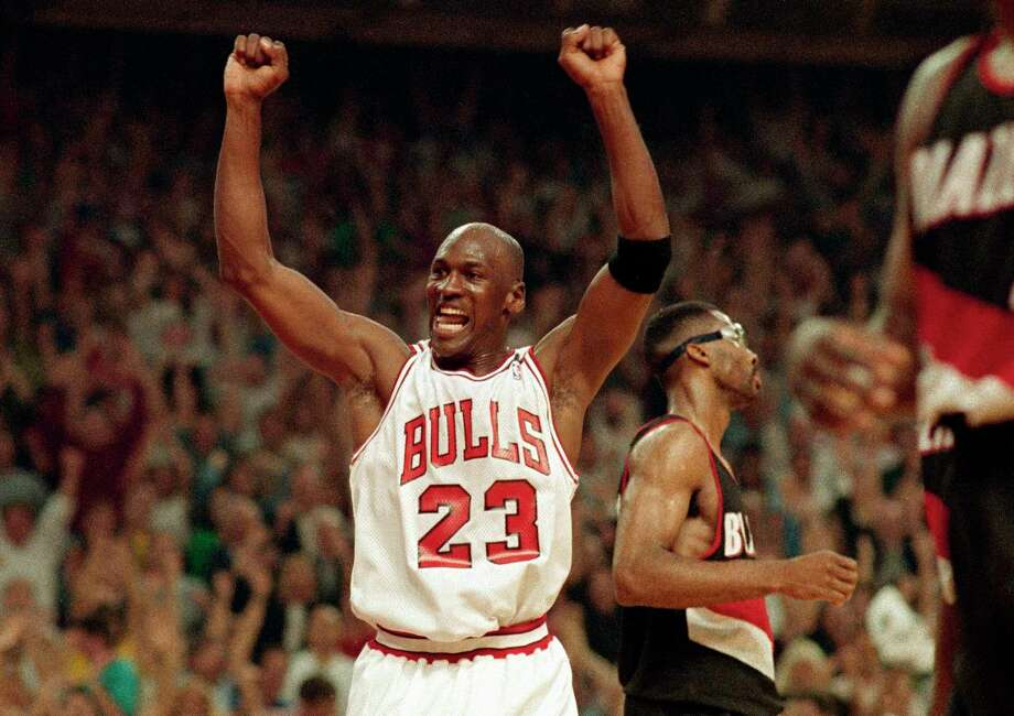 In this June 14, 1992, file photo, Michael Jordan celebrates the Bulls win over the Portland Trail Blazers in the NBA Finals in Chicago. Decades after Jordan's groundbreaking departure from college, March Madness and the NBA's mega-millions have taken all the novelty out of leaving early for the pros. Photo: John Swart, STF / Associated Press / 1992 AP
