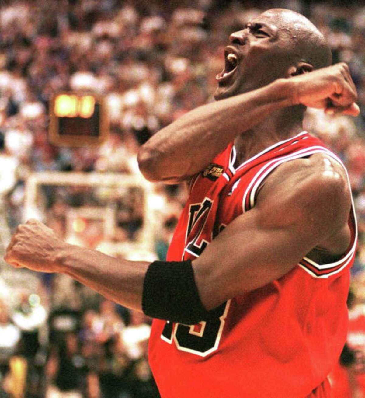 The Chicago Bulls' Michael Jordan celebrates after winning Game 6 of the NBA Finals against the Utah Jazz on June 19, 1984. (Robert Sullivan/AFP/Getty Images/TNS)