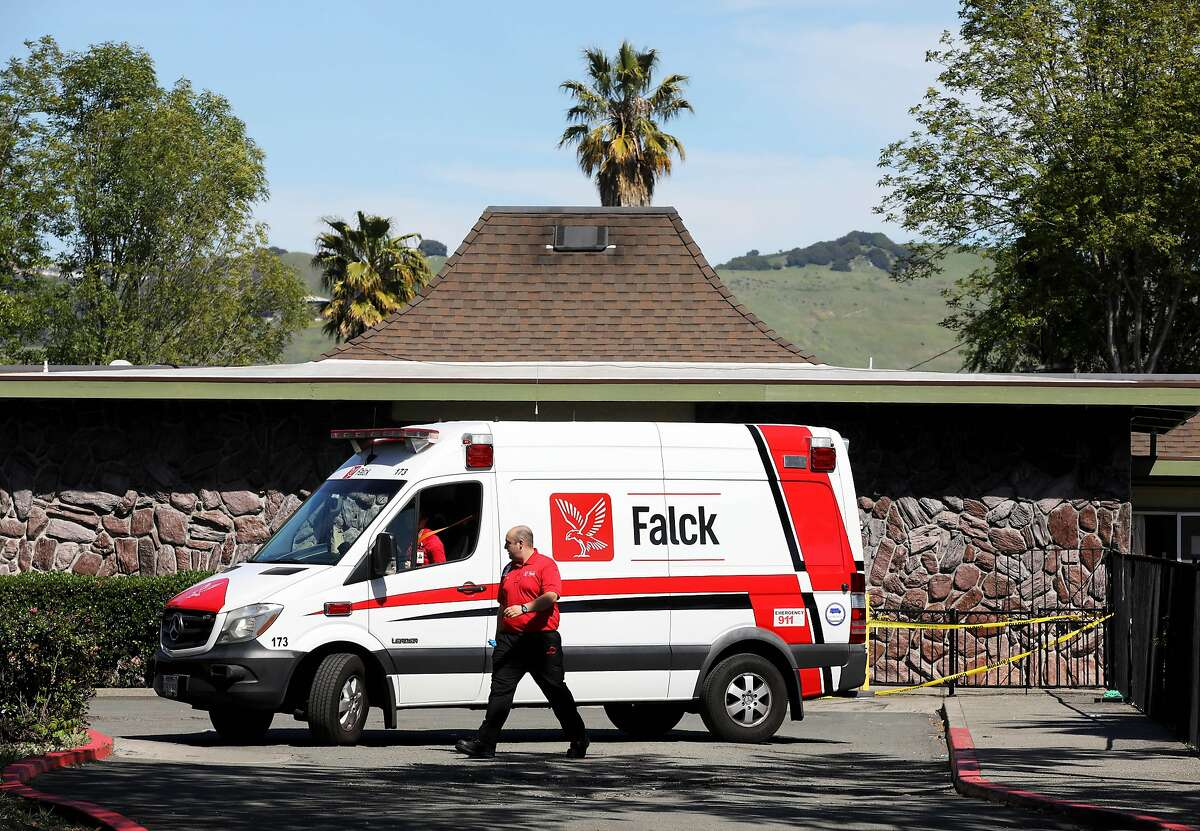 A Falck team prepares to leave after dropping off a patient at Gateway Care and Rehabilitation on Wednesday, April 15, 2020, in Hayward, Calif. The facility currently has eleven COVID-19 related deaths with dozens of staff members and patients infected with the novel coronavirus.