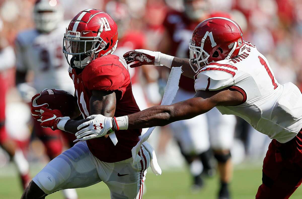 FILE: 2020 NFL Draft Top Prospects - Wide Receivers. TUSCALOOSA, ALABAMA - SEPTEMBER 07: Henry Ruggs III #11 of the Alabama Crimson Tide pulls in this reception against Ray Buford Jr. #1 of the New Mexico State Aggies at Bryant-Denny Stadium on September 07, 2019 in Tuscaloosa, Alabama. (Photo by Kevin C. Cox/Getty Images)