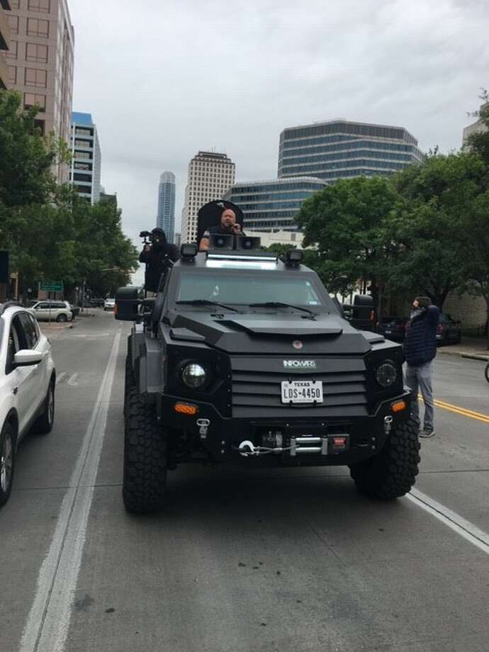 Conspiracy theorist and Infowars host Alex Jones arrives at a protest in Austin on Saturday, April 18, 2020, to call for the lifting of social, economic restrictions in the U.S. Photo: Eric Dexheimer