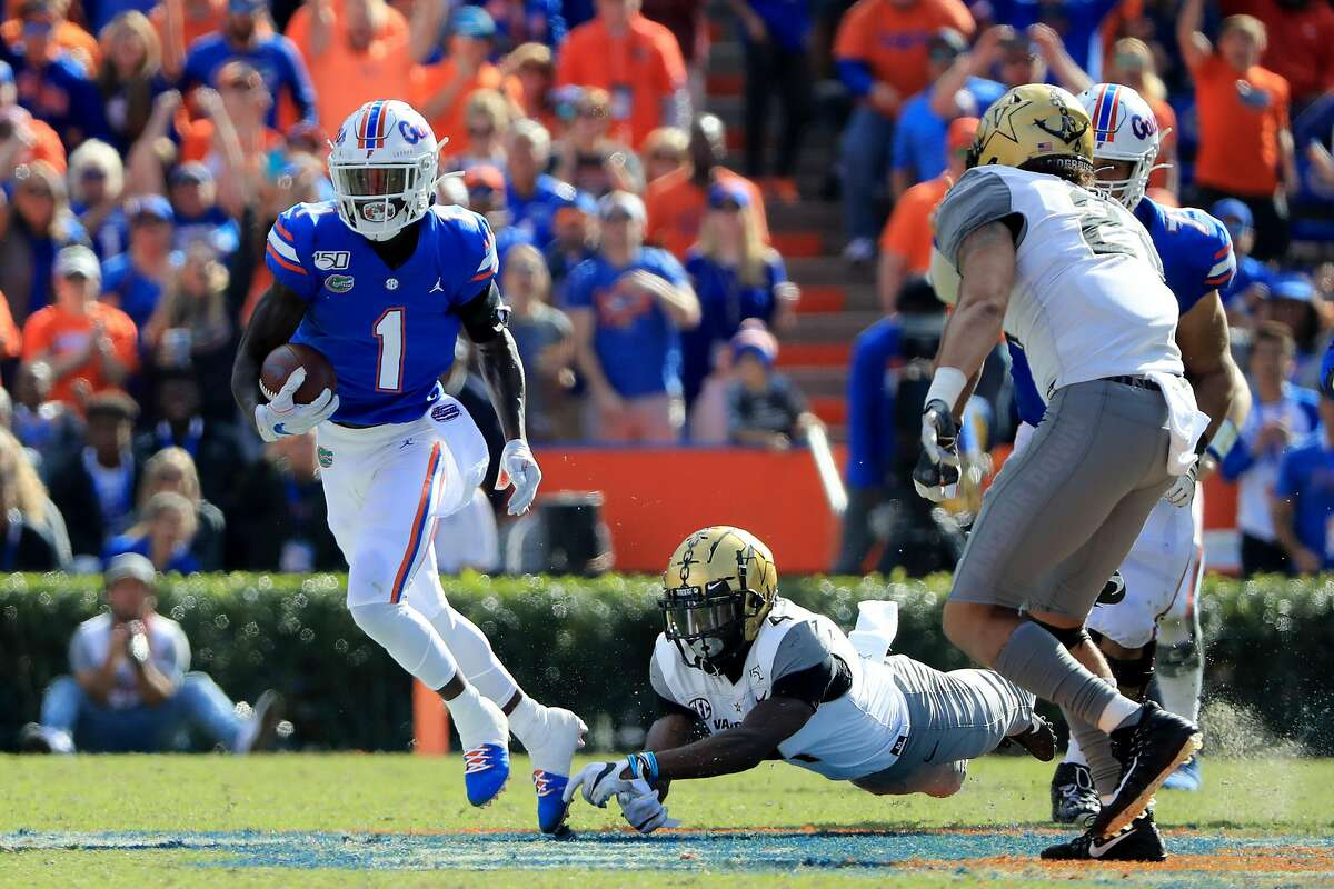 CJ Henderson #1 of the Florida Gators runs for yardage during the game against the Vanderbilt Commodores at Ben Hill Griffin Stadium on November 09, 2019 in Gainesville, Florida. (Sam Greenwood/Getty Images/TNS)