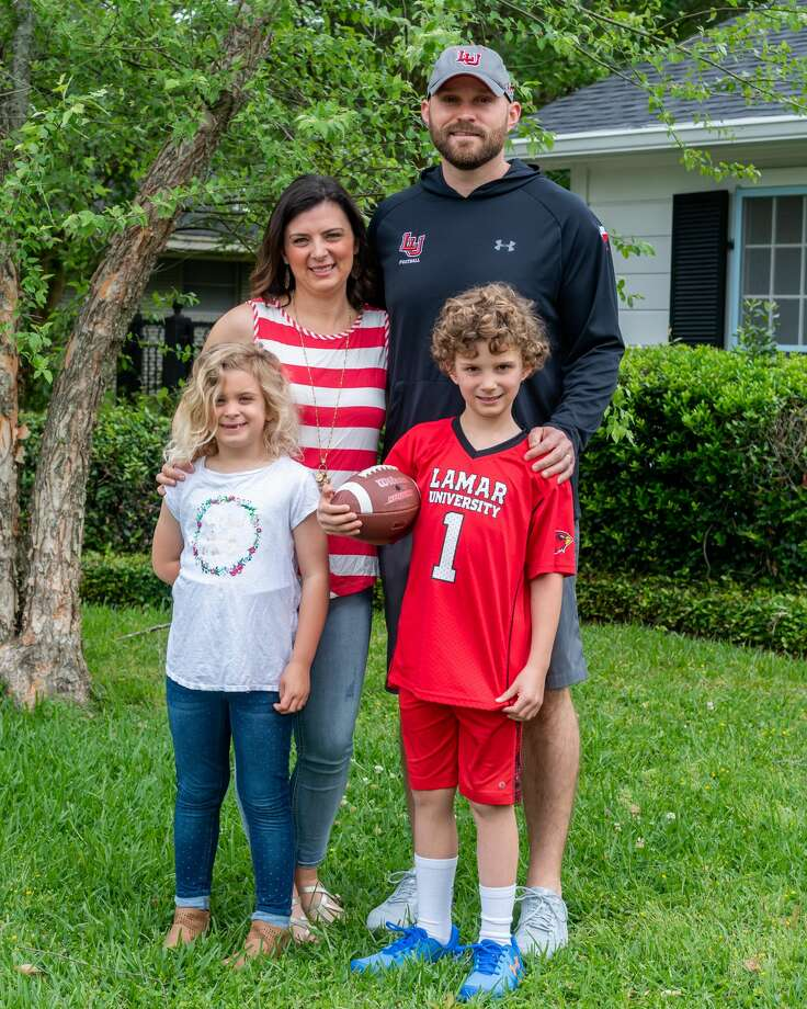 New Lamar assistant coach Patrick Covington, his wife Louise, son Gus, 7, and daughter Annie, 6, in the front yard of their new home in Beaumont. The new football offensive coordinator and his family had to adjust their moving plans with the growing threat of the coronavirus pandemic. Photographed on April 18, 2020. Fran Ruchalski/The Enterprise Photo: Fran Ruchalski/The Enterprise / ? 2020 The Beaumont Enterprise