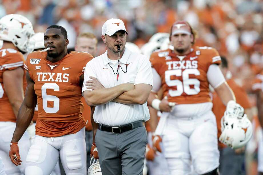 Texas football coach Tom Herman, center, has been active as a donor and volunteer at several Austin nonprofits such as the Central Texas Food Bank since the coronavirus outbreak. Photo: Tim Warner / Getty Images / 2019 Getty Images
