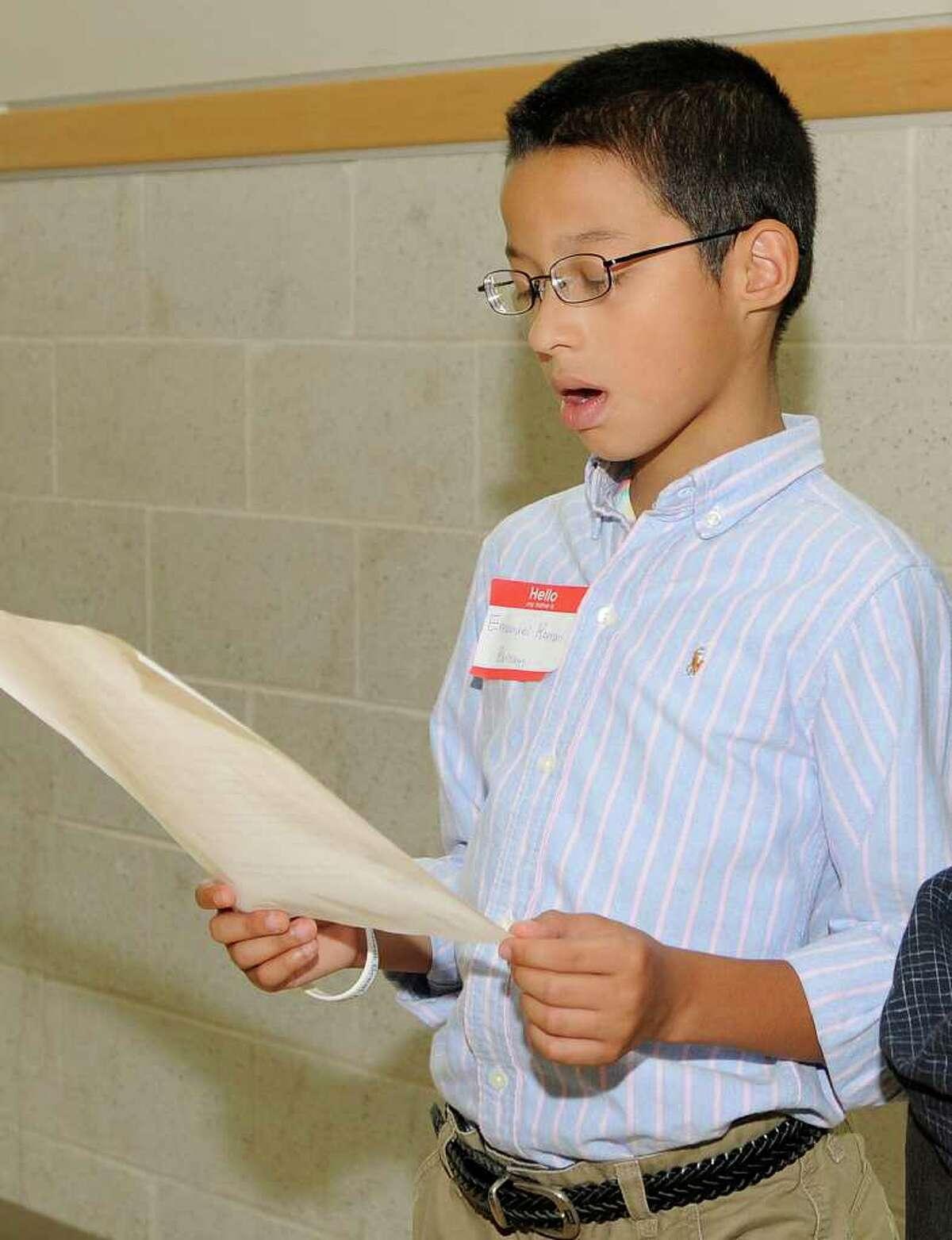 Emanuel Roman, 11, recites a