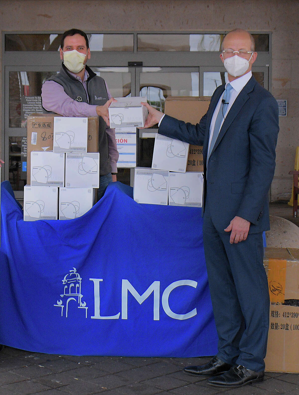 In an effort to help the medical staff at Laredo Medical Centerand Doctors Hospital, Dr. Michael A. Hochman, right, donated 2,000 protective medical grade N-95 virus-resistant face masks to each of the centers, Friday, April 17, 2020. Accepting the donation for the Laredo Medical Center is Chief Operating Officer, Jorge Leal.