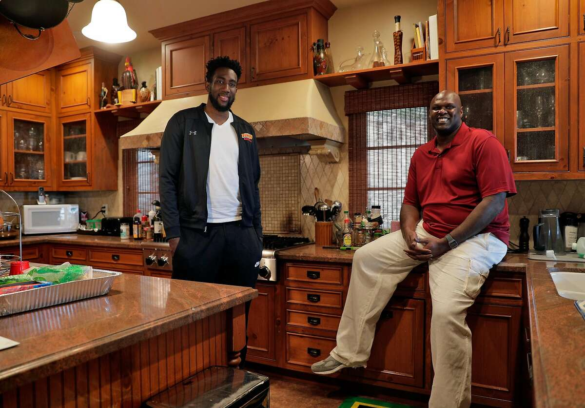 Former Warriors player Adonal Foyle in his kitchen with Consolo Adams, a college player from Foyle's home country who was forced to stay with him during lockdown at Adonal's home in Orinda, Calif., on Thursday, April 16, 2020. Foyle was hosting Adams, who attends the University of District Columbia with funding from Adonal's Kerosene Lamp Foundation, at his home when the coronavirus shutdown arrived.