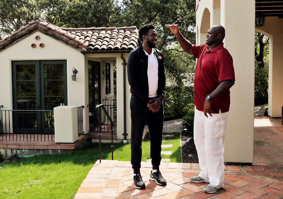 Former Warriors player Adonal Foyle teases Consolo Adams about his height at Foyle's home in Orinda, Calif., on Thursday, April 16, 2020. Foyle was hosting Adams, who attends the University of District Columbia with funding from Adonal's Kerosene Lamp Foundation, at his home when the coronavirus shutdown arrived. Adams has been staying with Foyle for several weeks until the lockdown is lifted.