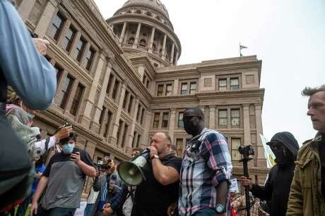 Alex Jones moves through the protesters gathering at the Texas Capitol in Austin looking to end to the coronavirus shutdowns, Saturday, April 19, 2020.(Stephen Spillman / for Express-News)