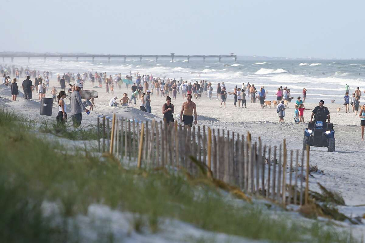 People crowd the beaches in Jacksonville Beach, Fla., after it was reopened by the city's mayor.