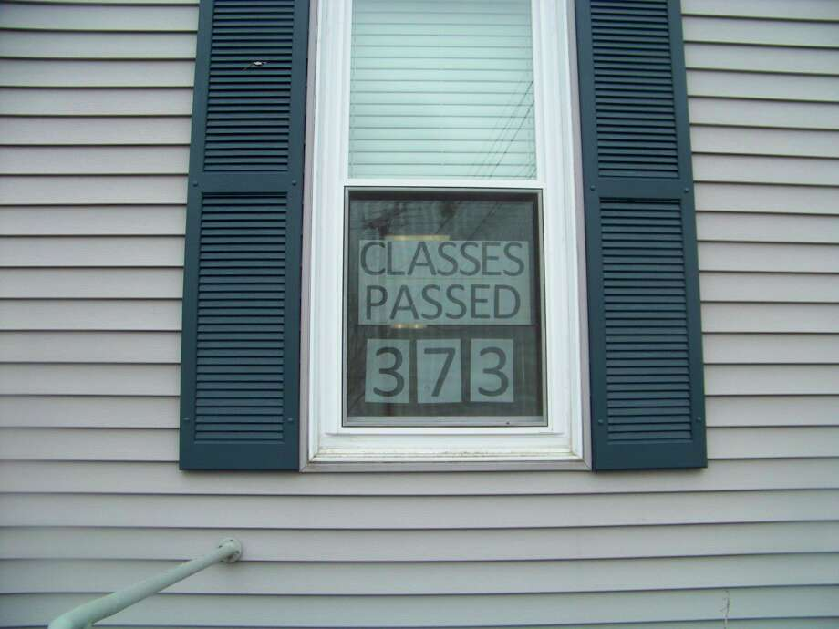 To recognize students' successes, Big Rapids Virtual School has been posting the number of classes students pass on the window of their building. Before the school closures, students would be able to come into the building and track their progress. (Courtesy photo)
