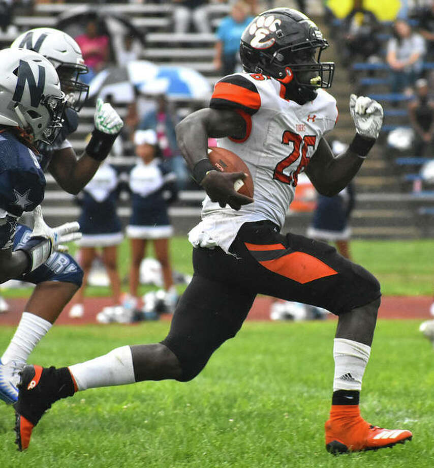 Edwardsville running back Justin Johnson Jr. breaks away from the McCluer North defense for a touchdown in the first quarter of last season's opener. Photo: Matt Kamp|The Intelligencer