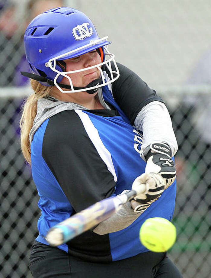 North Greene's Karissa Woosley swings at a pitch in a Class 1A sectional game against Jacksonville Routt last season. Woosley led the Spartans with a .468 batting average and is back for her junior season in 2020. Photo: Dennis Mathes / Hearst Illinois