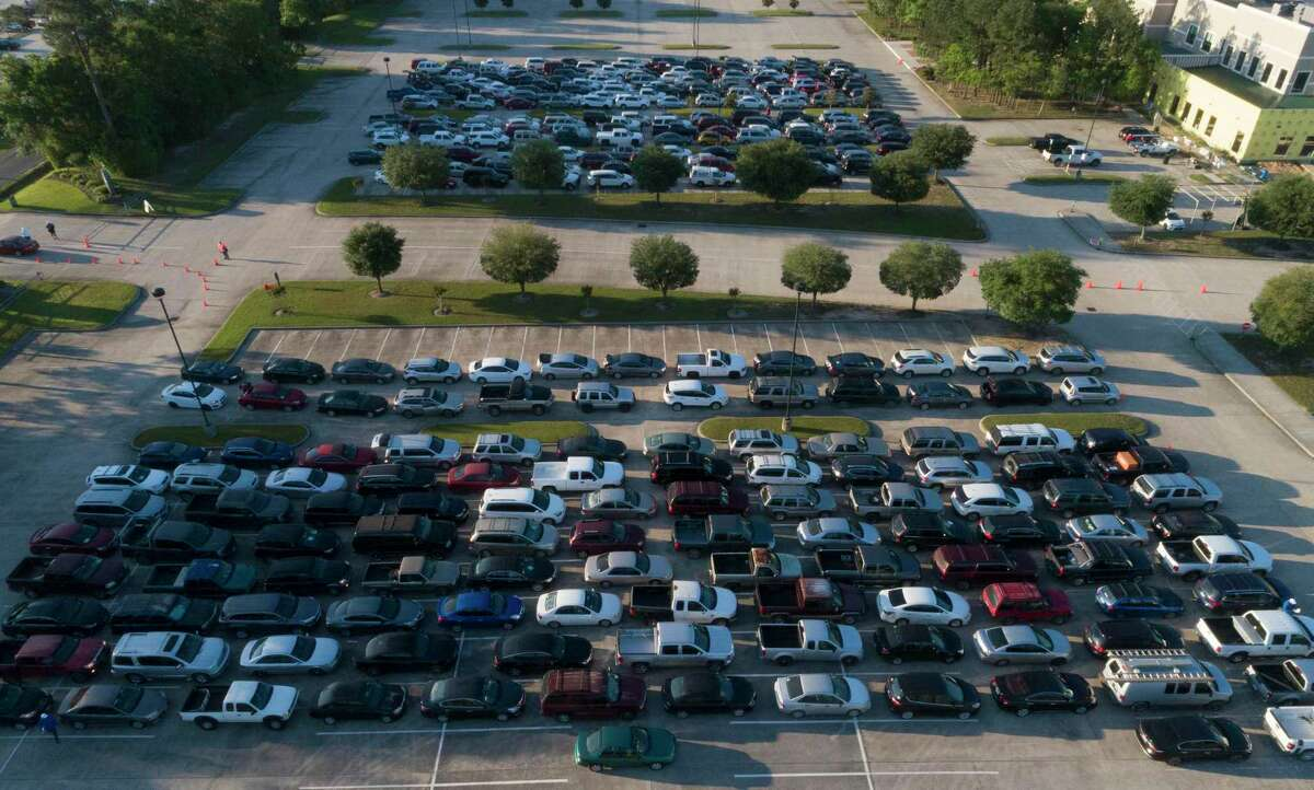 Vehicles lined up in April as the Community Assistance Center distributed food to 500 families at The Ark Church in Conroe. Three organizations in Montgomery County have received funding to distribute as rental assistance from the Greater Houston COVID-19 Recovery Fund.