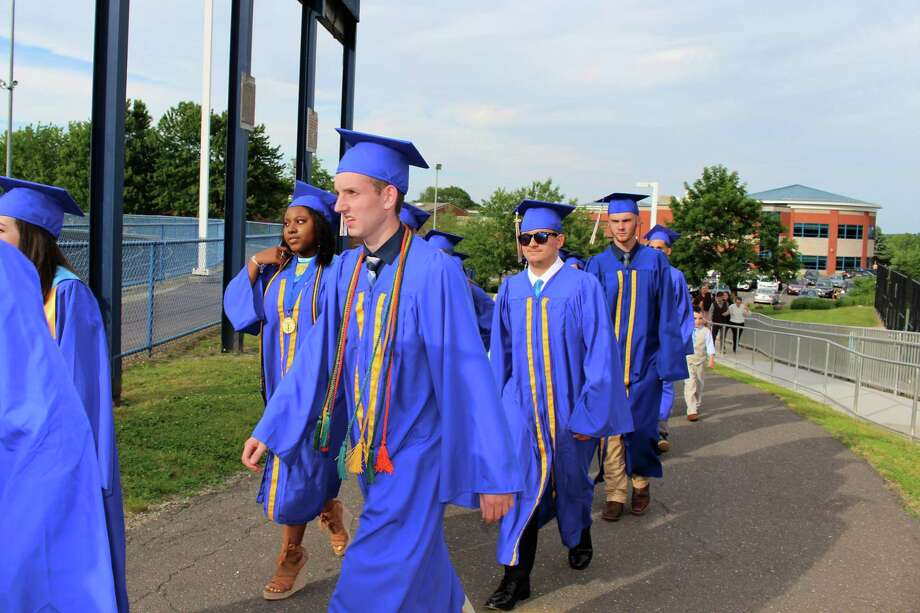 Seymour High School's Class of 2019 marches into their graduation ceremony. The Class of 2020 will have a chance to do the same if at all possible, according to Principal James Freund. Photo: Jean Falbo-Sosnovich / For Hearst Connecticut Media