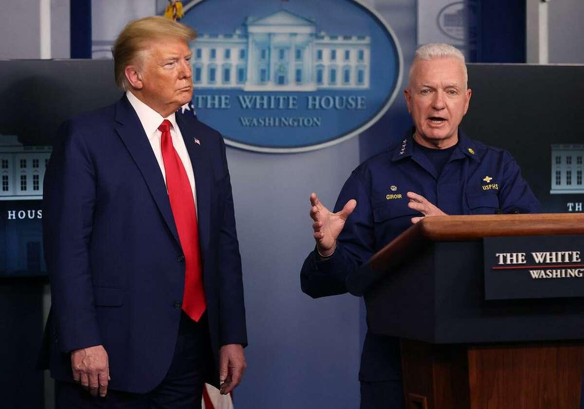 President Trump listens to coronavirus testing chief Adm. Brett Giroir, assistant secretary of health and human services.