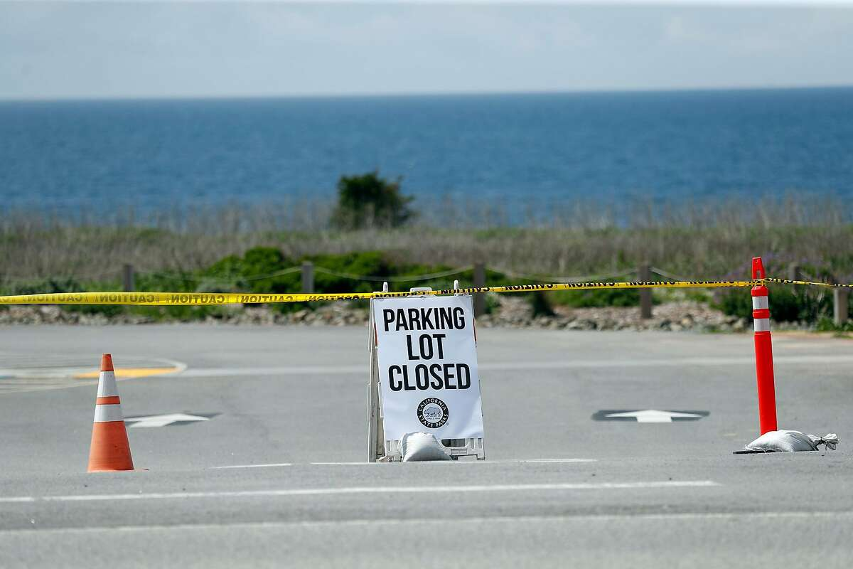 The parking lot at Montara State Beach, along with all other California state parks, has been closed to limit visitors during coronavirus outbreak in Montara, Calif., on Sunday, March 29, 2020.