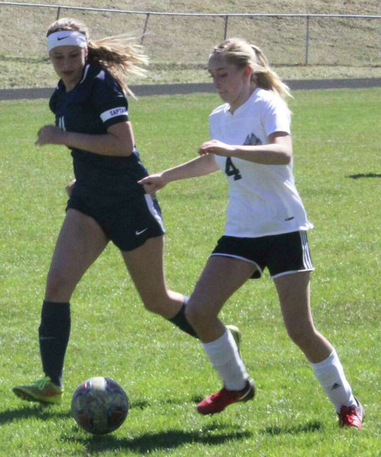 Reed City's Claudia Francke (right) battles for the ball against Crossroads Charter Academy during action last season. (Pioneer file photo)