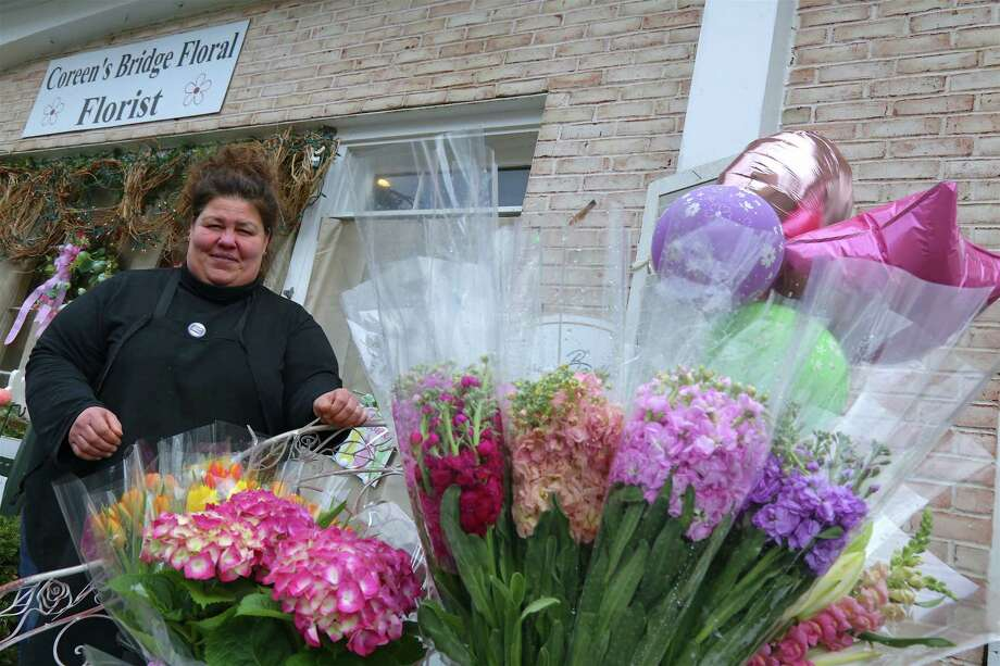 Coreen Pace, owner of Coreen's Bridge Floral in Greenfield Hill hopes to spread some color during a somewhat dark time, seen here on on Saturday, April 18, 2020, in Fairfield, Conn. Photo: Jarret Liotta / Jarret Liotta / ©Jarret Liotta 2020