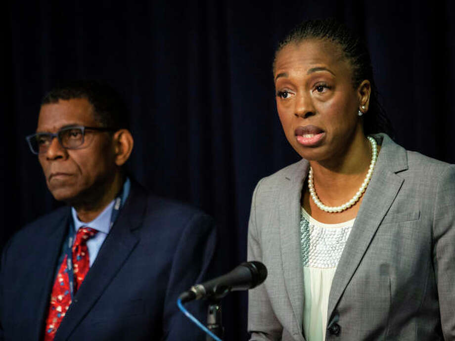 Dr. Terry Mason, left, chief operating officer of the Cook County Department of Public Health, looks on as Dr. Ngozi Ezike, right, director of the Illinois Department of Public Health, discusses the second confirmed case of a new virus in Illinois during a press conference at the Thompson Center, Thursday, Jan. 30, 2020, in Chicago. Health officials are reporting the first U.S. case of person-to-person spread of the new virus from China. The latest patient is the husband of the Chicago woman who got sick after she returned from a trip to China. Photo: Ashlee Rezin Garcia/Chicago Sun-Times