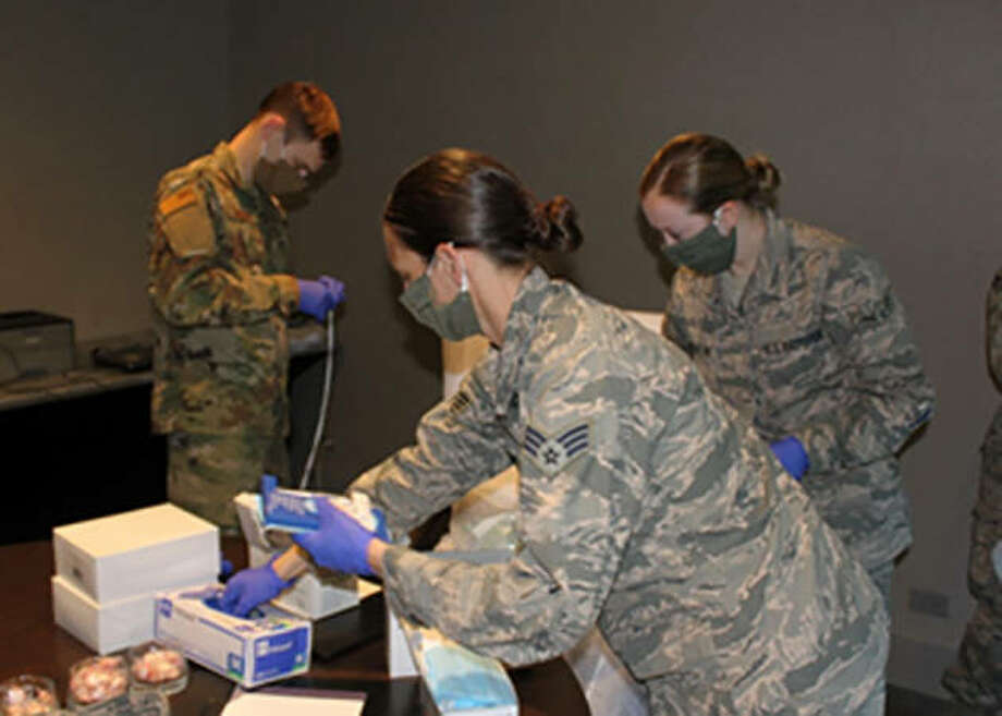 Airmen from the Illinois Air National Guard's 182nd Airlift Wing prepare personal hygiene kits while serving in a logistics support role at an alternate care facility for COVID-19 patients. Photo: Todd A. Pendleton | Air National Guard