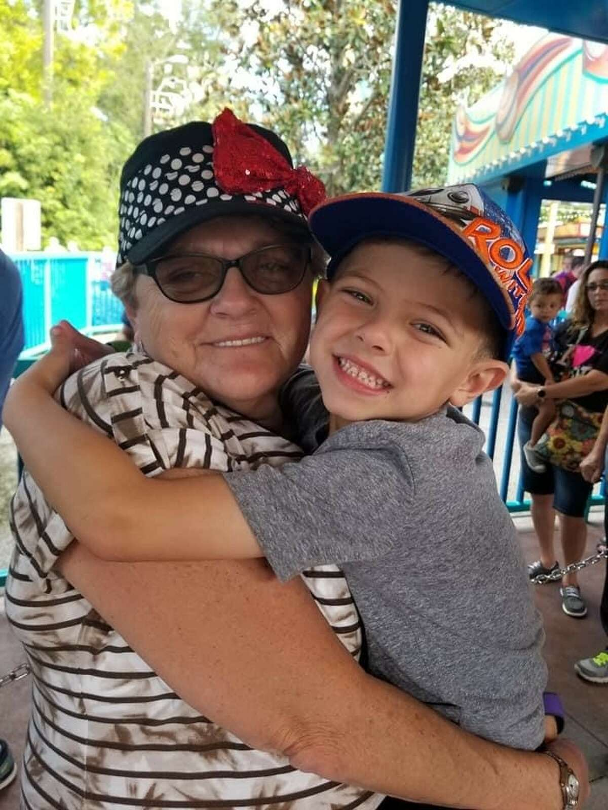 Shirley Reittinger, 65, of Latham, pictured with one of her grandchildren. Reittinger died April 9 in Florida from COVID-19.