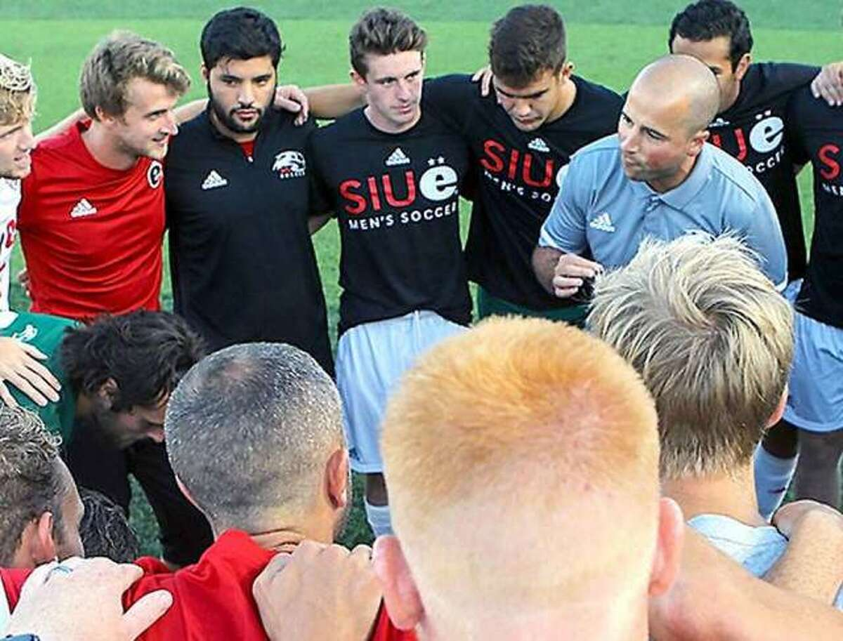 SIUE men's soccer coach CaleWassermann, right, gives pre-game instructions to his team last season. Wassermann, his coaching staff and players are conducting online sessions daily during the coronavirus pandemic.