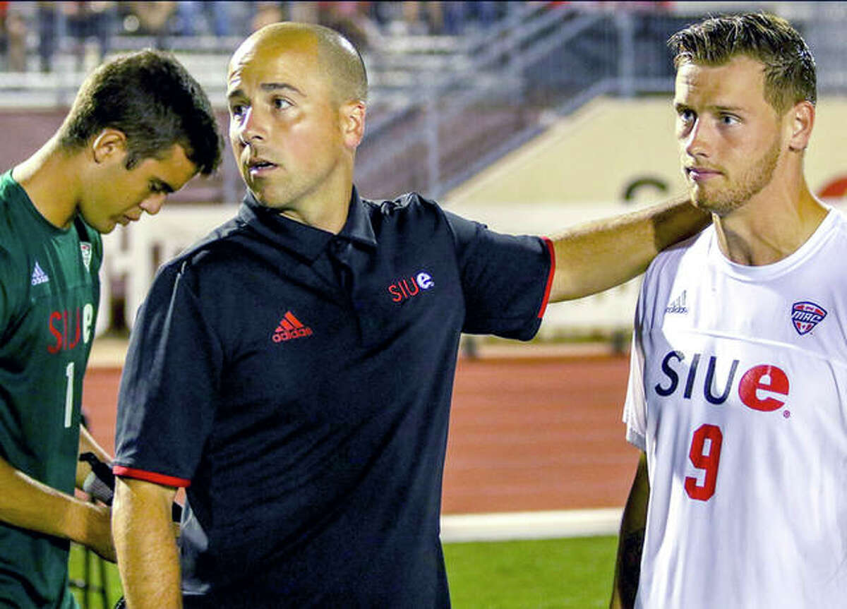 SIUE coach Cale Wassermann, center, gives instructions to Lachlan McLean, right, and goalie Lluís Martorell last season.