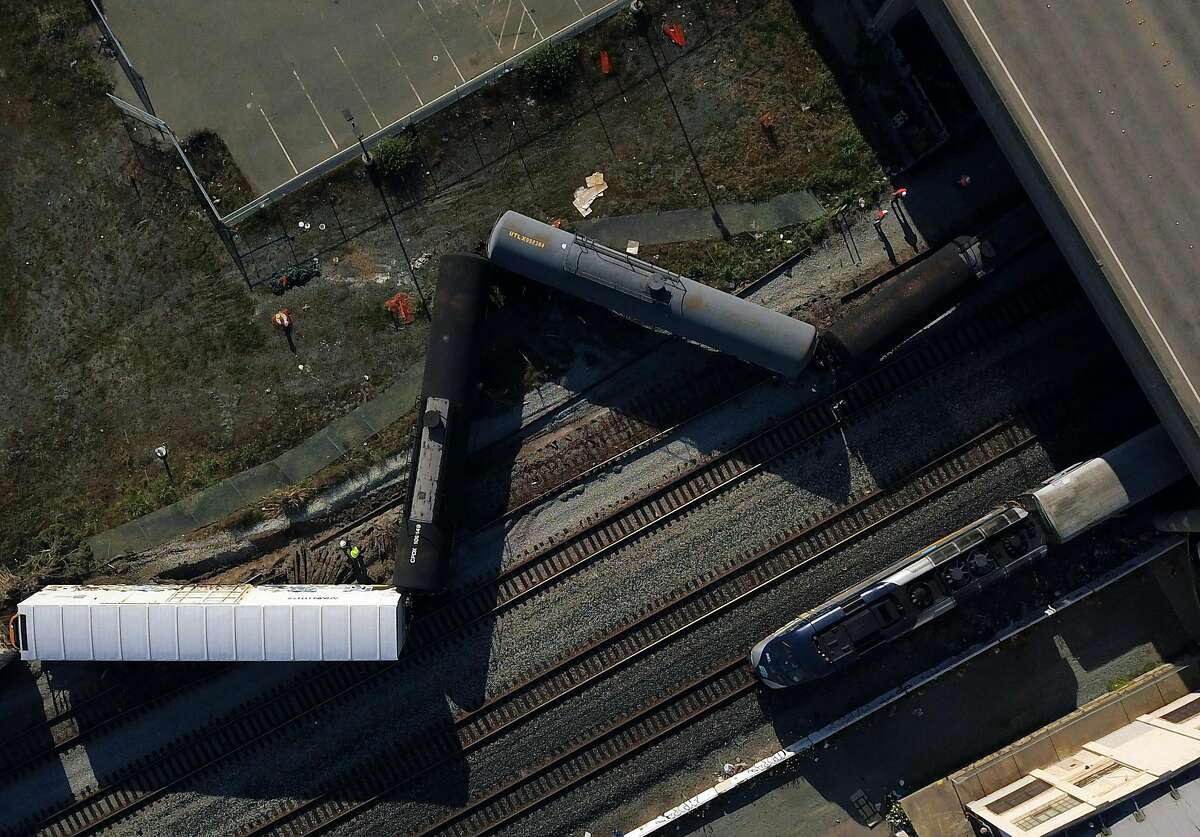 An Amtrak train approaches the Emeryville station on tracks adjacent to where a Union Pacific freight train derailed at Shellmound Street under the Powell Street overpass in Emeryville, Calif., on Sunday, April 19, 2020. The rail company said six cars derailed and blocked several street crossings for several hours.