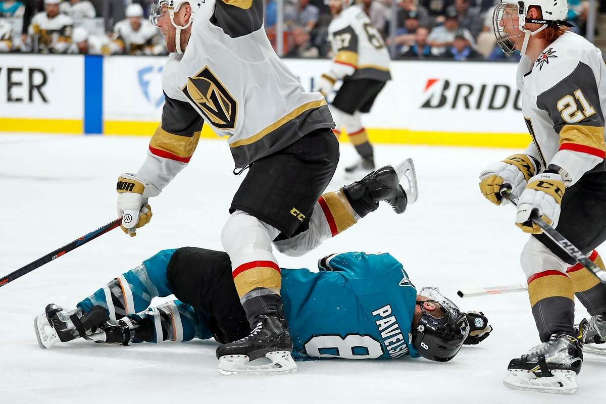 Vegas Golden Knights' Paul Stastny skates over San Jose Sharks' Joe Pavelski as he lays injured in 3rd period during Game 7 of NHL Western Conference 1st round playoff game at SAP Center in San Jose, Calif., on Tuesday, April 23, 2019. The Sharks would score 4 goals on the ensuing 5 minute major penalty on Cody Eakin (21).