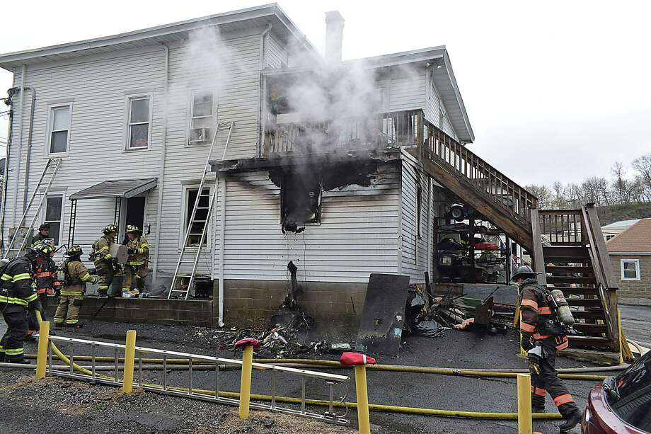 Emergency personnel respond to a structure fire on Locust Avenue in Danbury, Conn., on April 18, 2020. Photo: Contributed Photo / Rob Fish