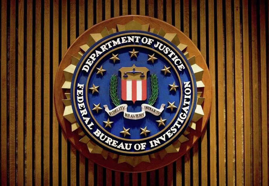 A crest of the Federal Bureau of Investigation inside the J. Edgar Hoover FBI Building in Washington, D.C. Photo: Getty Images / AFP