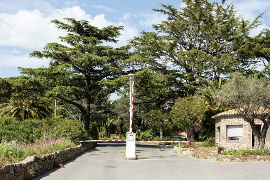 The entrance of Les Parcs de Saint-Tropez is protected by a security fence, gatehouse and guard.. Photo: Photo For The Washington Post By Sandra Mehl / Sandra Mehl