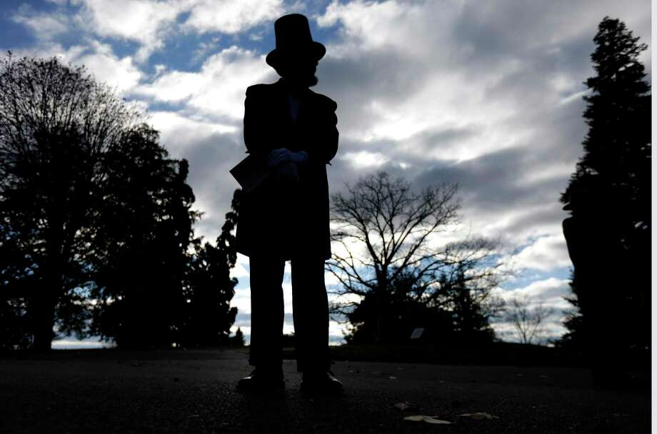 """An actor portraying President Abraham Lincoln stands before a ceremony marking the 150th anniversary of the dedication of the Soldiers' National Cemetery the Gettysburg Address in Gettysburg, Pa., in 2013. When Lincoln helped dedicate a cemetery at Gettysburg, he resolved """"that from these honored dead we take increased devotion to that cause for which they gave the last full measure of devotion."""" Photo: Matt Rourke / Associated Press / AP"""