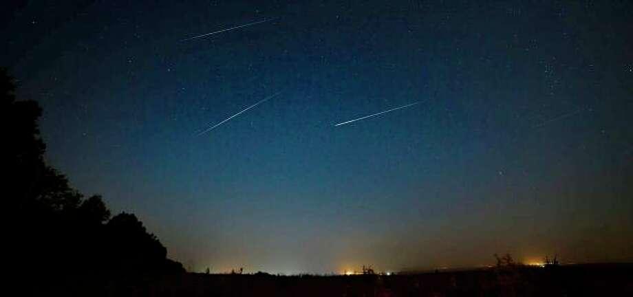 Three shooting stars streaking across the night sky. (NASA, courtesy of AccuWeather)