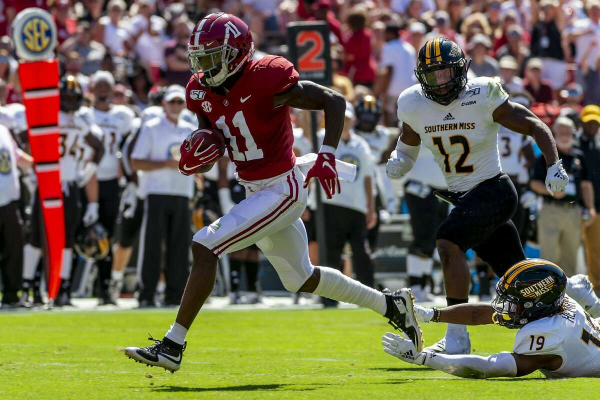 FILE - In this Sept. 21, 2019, file photo, Alabama wide receiver Henry Ruggs (11) runs in for a touchdown on a pass reception against Southern Mississippi during the first half of an NCAA college football game in Tuscaloosa, Ala. The Raiders have the 12th and 19th picks in the NFL draft thanks to the 2018 trade that sent star pass rusher Khalil Mack to the Chicago Bears. Several receivers are projected to go in the first round. Ruggs and Oklahoma's CeeDee Lamb are considered by many analysts to be the best of the bunch. (AP Photo/Vasha Hunt, File)