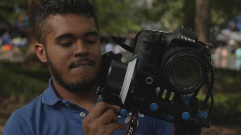 A journalist at ITESM captures footage. Photo: Courtesy Maria Del Carmen Fernández Chapou