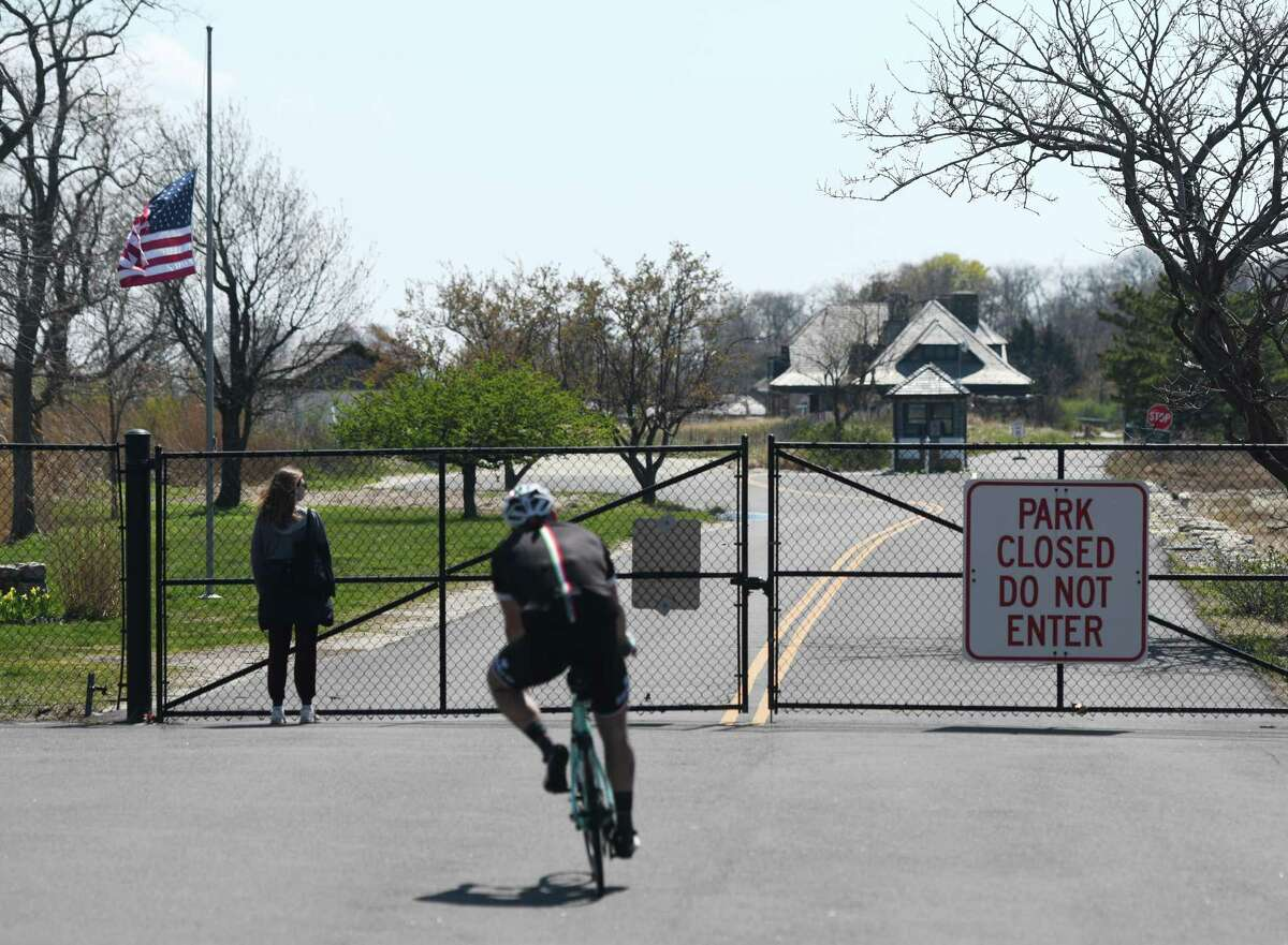 The gate restricting access to Greenwich Point will be open again starting Thursday morning as areas will be open for walking, running and bicycling.