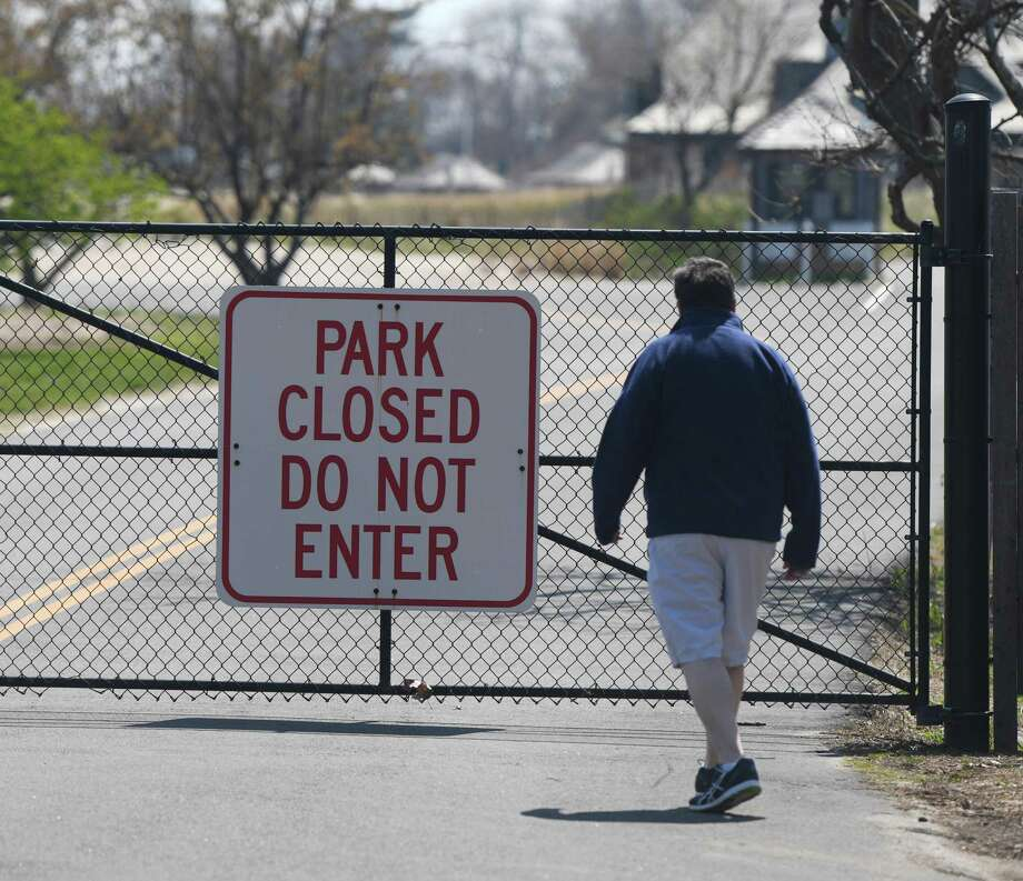 The closed gates at Greenwich Point look to soon reopen as starting May 7, there will be limited uses allowed. Photo: Tyler Sizemore / Hearst Connecticut Media / Greenwich Time