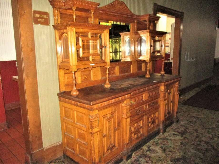 "A complete liquidation of Spaghetti Warehouse's furniture, decorative antiques, kitchen equipment and dishes is underway online. The sale, hosted by RCI Online Auctions, includes 10 pages of items up for bid. Of the more than 450 items, there's an antique parlor stove, old cash registers, Tiffany-style lamps, waiting area sofas and a 1900 sideboard which ""appears haunted,"" the listing says. Photo: Courtesy, RCI Auctions South Texas"