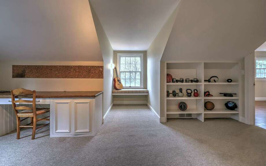 The bonus room is quite large and features a built-in desk area or homework station, shelving, a window seat, and closet. Photo: Picasa