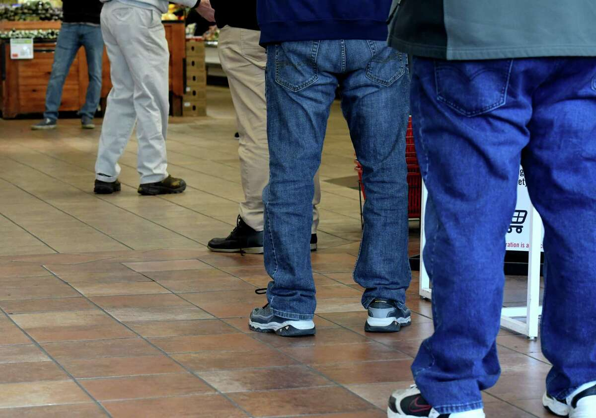 People wait in line to be tested for COVID-19 antibodies by the New York State Department of Health on Monday, April 20, 2020, at a supermarket on Central Avenue in Albany, N.Y. (Will Waldron/Times Union)