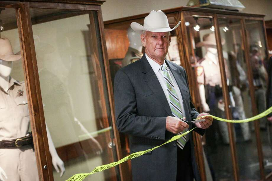 Former sheriff Joe Corley cuts the ribbon for the Montgomery County Sheriff's Office Museum unveiling on Monday, Dec. 19, 2016, at the Montgomery County Sheriff's Office. Photo: Michael Minasi, Staff / Houston Chronicle / © 2016 Houston Chronicle