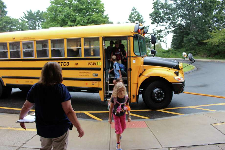 South Elementary School students get off the bus in New Canaan on the first day of school in 2016. Photo: Justin Papp / Hearst Connecticut Media / New Canaan News