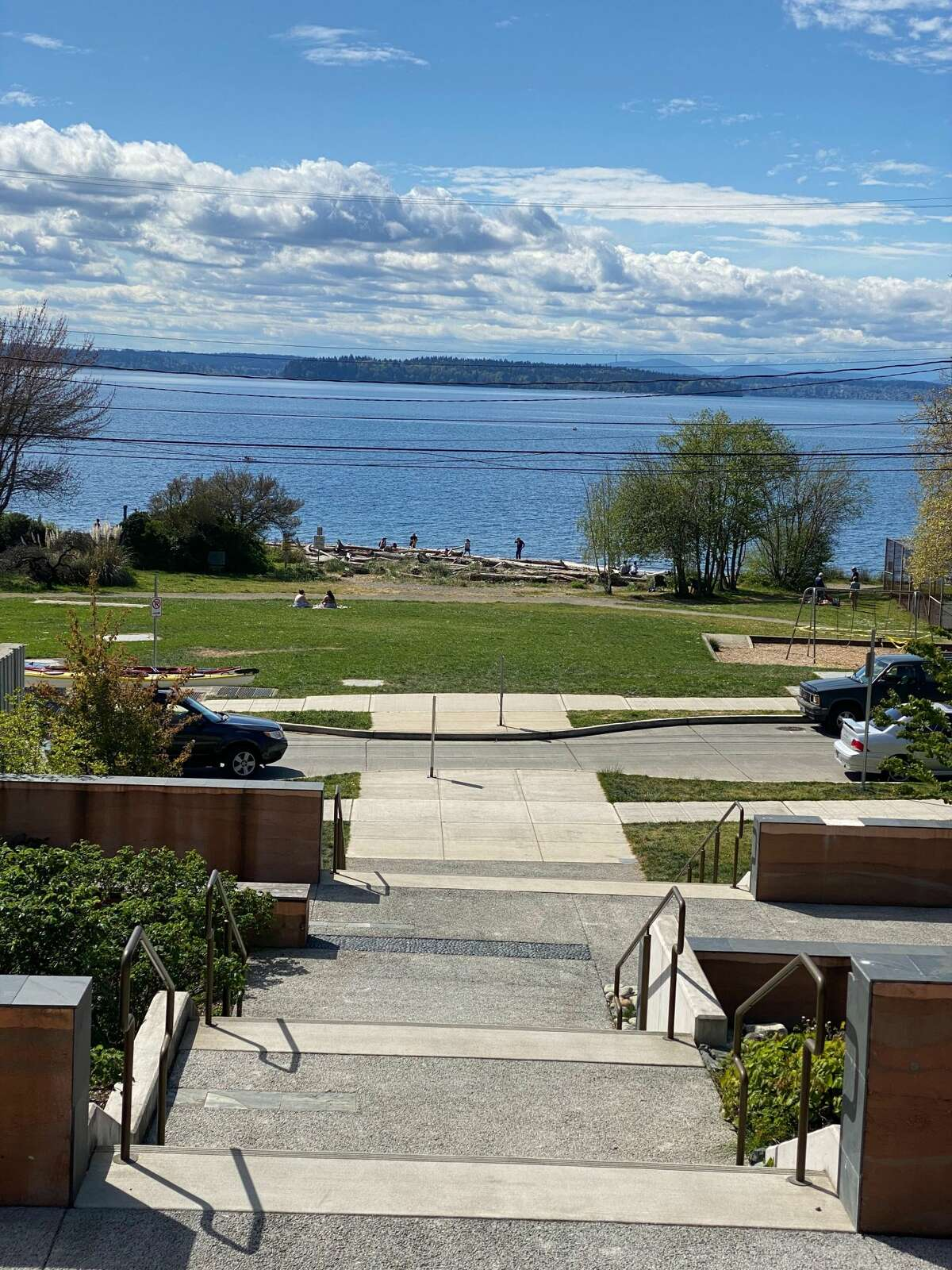 Lowman Beach Park in West Seattle features a rugged beach, tennis court, a grassy area and swings.