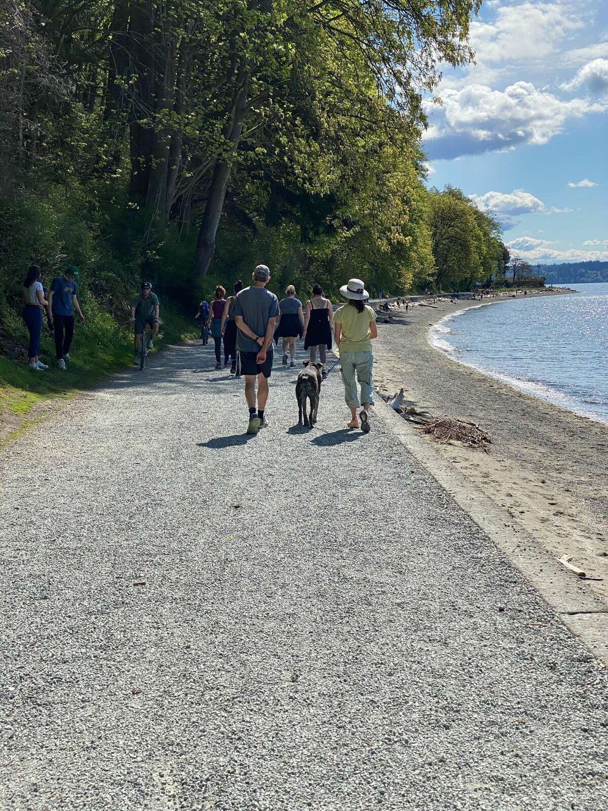 People walking on a sunny day at Lincoln Park in West Seattle, Wash. on April 19, 2020.