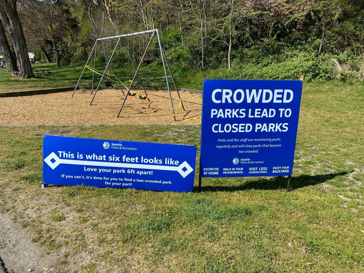 Social distancing signs posted at Lincoln Park in West Seattle, Wash. on April 19, 2020.