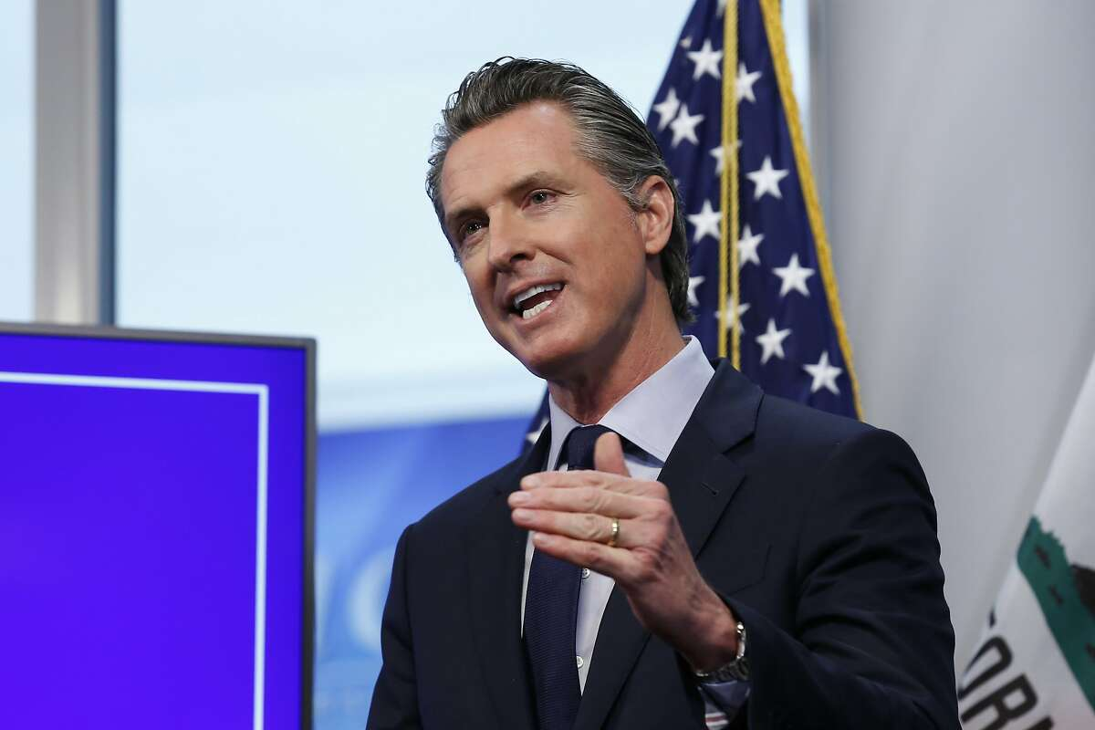 """FILE - In this file photo taken Tuesday April 14, 2020, California Gov. Gavin Newsom discusses an outline for what it will take to lift coronavirus restrictions during a news conference at the Governor's Office of Emergency Services in Rancho Cordova, Calif. President Donald Trump declared that states could """"call your own shots"""" in determining how and when to loosen restrictions on businesses and social gatherings. Clusters of states representing the vast majority of Americans have decided cooperation in dealing with the coronavirus is the better option. (AP Photo/Rich Pedroncelli,File)"""