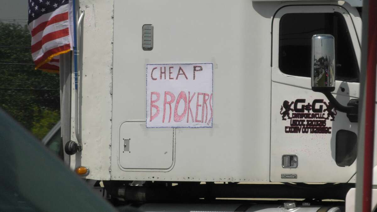 A group of truckers block part of the North Loop near Gellhorn in a protest of some sort Monday, April 20, 2020.