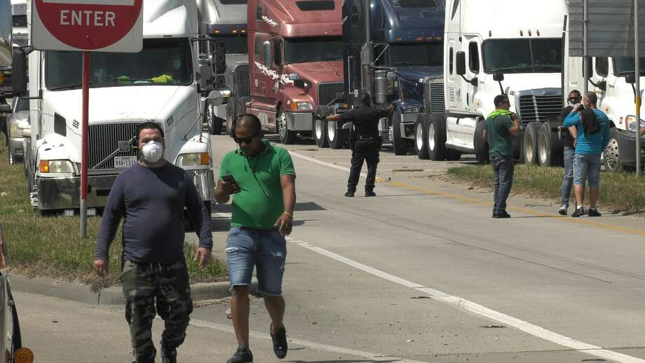 A group of truckers block part of the North Loop near Gellhorn in a protest of some sort Monday, April 20, 2020. Photo: Jay R. Jordan / Houston Chronicle